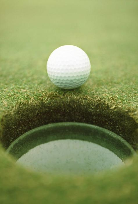 golf-ball-beside-hole-close-up-ken-reid